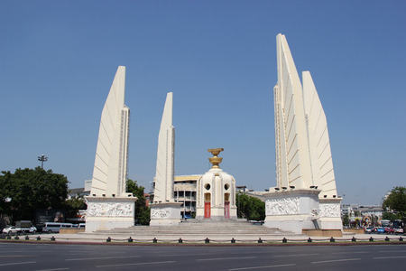 constitutional: Bangkok Thailand  April 21 2015: The Democracy Monument is a public monument commemorating the 1932 Siamese Revolution which lead to the establishment of a constitutional monarchy in Thailand. Editorial