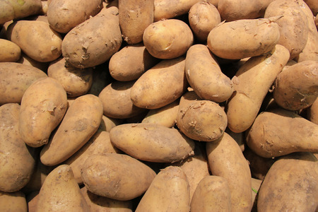 russet potato: Pile of Brown Potatoes Sold at a Market Stock Photo