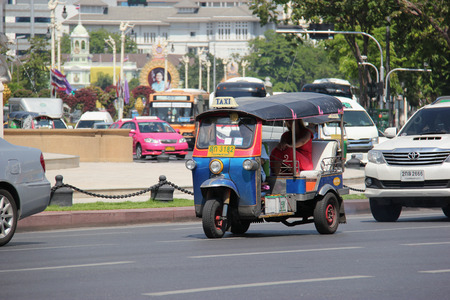 tuktuk: Bangkok Thailand  April 21 2015: The auto rickshaw known as tuktuk is a widely used form of urban transportation in Bangkok and other Thai cities. It is one of symbols of Thailand.