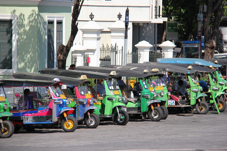 auto rickshaw: Bangkok Thailand  April 21 2015: The auto rickshaw known as tuktuk is a widely used form of urban transportation in Bangkok and other Thai cities. It is one of symbols of Thailand.