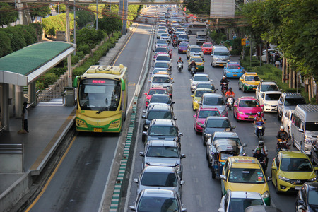 rapid: Bangkok Thailand  April 28 2015: The Bangkok BRT is a bus rapid transit system in Bangkok. As it runs on dedicated bus lane in the center of the road it blocks the traffic and is criticized that it has worsened the traffic in the area.