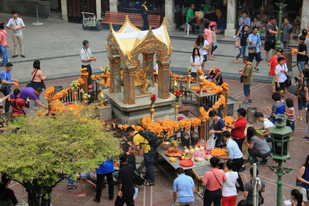 hindu: Bangkok Thailand  April 30 2015: People are paying respect to the Erawan Shrine which is a Hindu shrine housing a statue of Phra Phrom the Thai representation of the Hindu creation God Brahma.