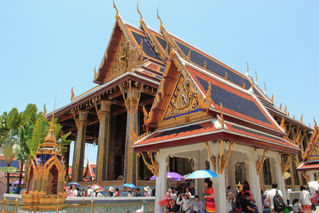 potent: Bangkok, Thailand - April 21, 2015: Emerald Buddha Temple is the most sacred Buddhist temple, a potent religion-political symbol and the palladium of Thai society. Editorial