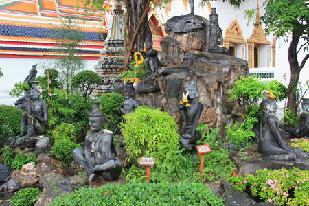hermits: The Statues of Hermits Exercising at Wat Pho, which is home to one of the earliest Thai massage schools.