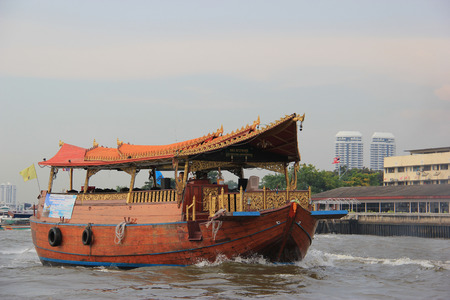 phraya: Bangkok, Thailand - May 8, 2015: Ship decorated in Thai style provides a cruise tour with meal and karaoke.