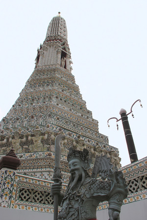 wat arun: Statue of Chinese Warrior at Wat Arun or Temple of Dawn, Thailands landmark known for the first light of the morning reflecting off the surface of the temple with pearly iridescence.