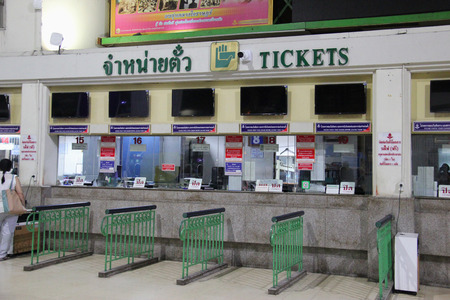 approximately: Bangkok, Thailand - May 8, 2015: Train ticket booths at Bangkok Railway Station, which serves over 130 trains and approximately 60,000 passengers each day.