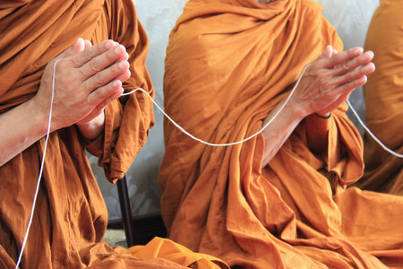 clergyman: Buddhist monks are praying and blessing people. Stock Photo
