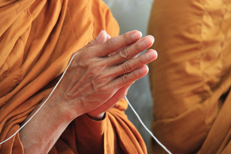 cleric: Buddhist monks are praying and blessing people. Stock Photo