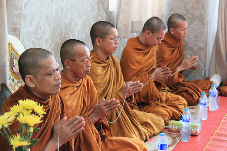 cleric: Bangkok, Thailand - May 10, 2015: Buddhist monks are praying and blessing people.