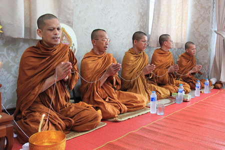ascetic: Bangkok, Thailand - May 10, 2015: Buddhist monks are praying and blessing people.