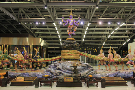 churning: Bangkok, Thailand - May 12, 2015: Sculpture of Churning of the Ocean of Milk is the main decoration at Departure Area at Suvarnabhumi Airport, the main airport of Bangkok, Thailand