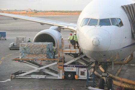 Bangkok, Thailand - May 12, 2015: Luggages and other merchandises are being loaded on the airplane at Suvarnabhumi Airport.