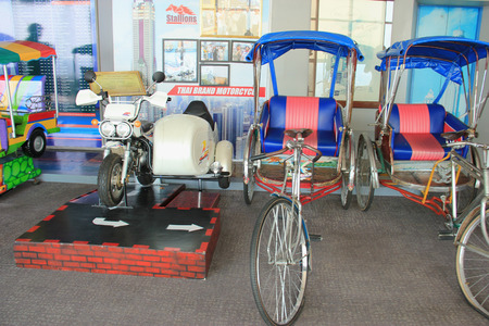 autorick: Bangkok, Thailand - April 28, 2015: Thai tricycles and Thai brand motorcycle are displayed on the observatory floor of Baiyoke Tower 2 in Bangkok, Thailand.