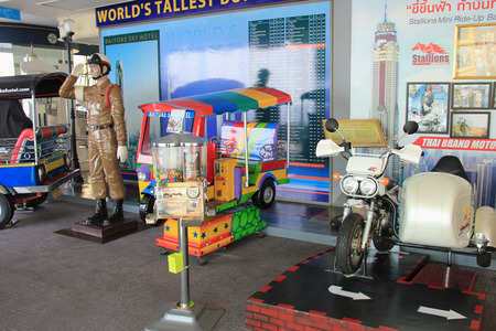 auto rickshaw: Bangkok, Thailand - April 28, 2015: Thai auto rickshaw and Thai brand motorcycle are displayed on the observatory floor of Baiyoke Tower 2 in Bangkok, Thailand. Editorial