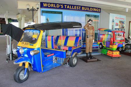 autorick: Bangkok, Thailand - April 28, 2015: Thai auto rickshaw and Thai brand motorcycle are displayed on the observatory floor of Baiyoke Tower 2 in Bangkok, Thailand. Editorial