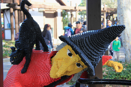 Carlsbad, California, USA - December 27, 2014: Witch and Black Cat Lego at Legoland California, a theme park and miniature park. It is the third Legoland Park to open and the first Legoland outside Europe.