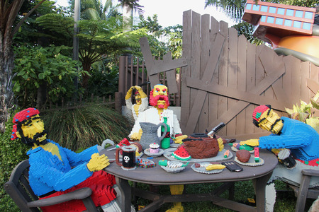 industrial park: Carlsbad, California, USA - December 27, 2014: Pirate Lego near Captain Crankys Challenge, the rucking tug ride, at Pirate Shores Area of Legoland California. Editorial