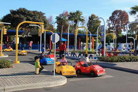 closed circuit: Carlsbad, California, USA - December 27, 2014: Promoting safe driving and skills, Volvo Driving School at Legoland California give children driving experience with Lego cars on a closed circuit featuring multiple intersections, two way traffic, traffic si