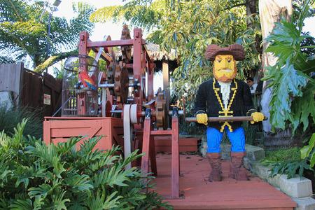 cranky: Carlsbad, California, USA - December 27, 2014: Pirate Lego near Captain Crankys Challenge, the rucking tug ride, at Pirate Shores Area of Legoland California. Editorial