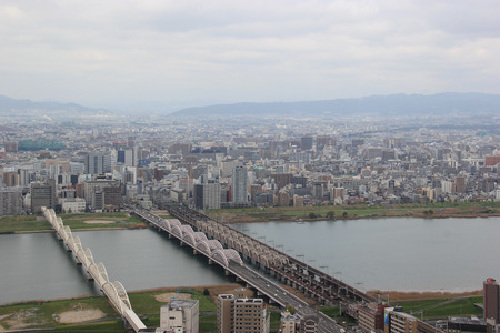 whose: Osaka, Japan - April 8, 2015: The Yodo River, whose source of the river is Lake Biwa in Shiga Prefecture to the north, is the principal river in Osaka Prefecture on Honshu, Japan.