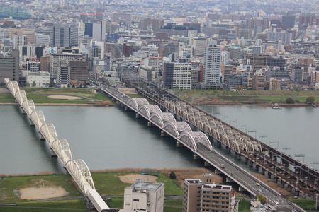 honshu: Osaka, Japan - April 8, 2015: The Yodo River, whose source of the river is Lake Biwa in Shiga Prefecture to the north, is the principal river in Osaka Prefecture on Honshu, Japan.