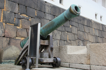 cannon gun: Osaka, Japan - April 8, 2015: Signal Gun or Noon Marker at Osaka Castle is a cannon from the Tokugawa era that was fired everyday to signal the noon hour.