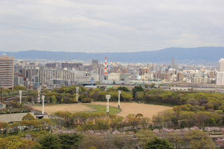 castle district: Osaka, Japan - April 8, 2015: Scenery of Baseball Field, one of the most popular sports in Japan, at Osaka Castle Park, a public urban park and historical site. Editorial