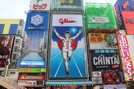 famous industries: Osaka, Japan - April 8, 2015: Glico billboard displaying the image of a runner crossing a finishing line, is an icon of Osaka, Japan. It is located in Dotonbori, a famous tourist destination for nightlife and entertainment area.