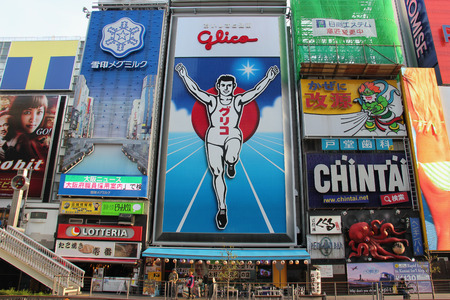 finishing line: Osaka, Japan - April 8, 2015: Glico billboard displaying the image of a runner crossing a finishing line, is an icon of Osaka, Japan. It is located in Dotonbori, a famous tourist destination for nightlife and entertainment area.