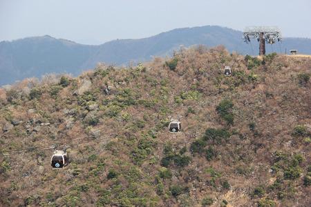 odawara: Hakone, Japan - April 9, 2015: The Hakone Ropeway, a part of the sightseeing route between Odawara and Lake Ashi, is aerial lift linking between Sounzan and Togendai via Owakudani.