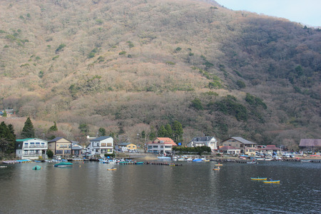 historical sites: Hakone, Japan - April 9, 2015: Lake Ashi, a crater lake that lies along the southwest wall of the caldera of Mount Hakone, is known for its views of Mount Fuji, hot springs and historical sites.