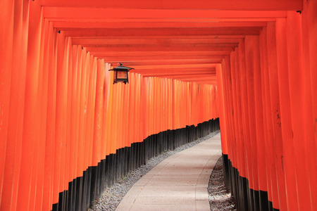 messengers of god: Fushimi Inari Taisha Shrine is the head shrine of Inari including trails up the mountain to many smaller shrines which span 4 kilometers. Editorial