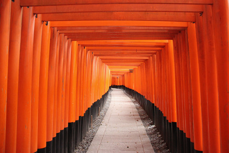 span: Fushimi Inari Taisha Shrine is the head shrine of Inari including trails up the mountain to many smaller shrines which span 4 kilometers in Kyoto, Japan.
