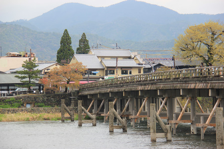 notable: Kyoto, Japan - April 11, 2015: Togetsukyo Bridge is notable for its views of cherry blossoms and autumn colors in Arashiyama, a nationally designated Historic Site and Place of Scenic Beauty.