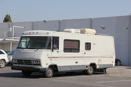 amenities: Recreational Vehicle RV is a motor vehicle or trailer equipped with living space and amenities found in a home. Stock Photo