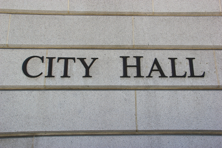 City Hall Sign on a Stone Wall