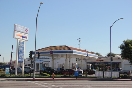priced: Huntington Park, California, USA - November 5, 2014: Atlantic Richfield Company ARCO is an American Oil Company with operations in the US, Indonesia, the North Sea, and the South China Sea. It is known for its low priced gasoline due to cost cutting and a Editorial