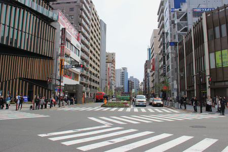 survives: Tokyo, Japan - April 12, 2015: Busy intersection with many crosswalks in front of Sensoji in Asakusa, one of Tokyos districts, where an atmosphere of the Tokyo of past decades survives.