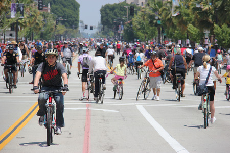 fun at work: Pasadena, California, USA - May 31, 2015: CicLAvia is an event held in Los Angeles where streets are closed to motor vehicles and open for the public to walk, bike and skate through open streets.