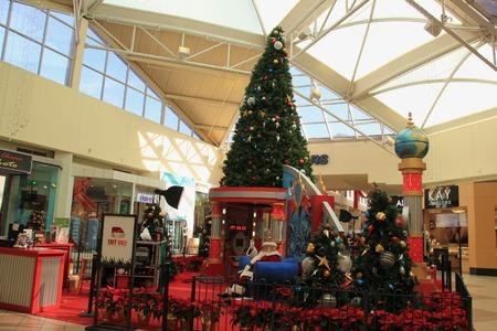 greeting season: Downey, California, USA - December 8, 2014: Santa Claus is greeting tourists at Christmas decorated area for Christmas season.