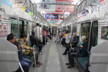 loco: Tokyo, Japan - April 13, 2015: Train and subway are popular public transportation for people in Japan as it is all connected and convenient. Editorial