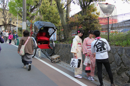 maiko: Kyoto, Japan - April 11, 2015: Unidentified Japanese women wear Kimono, beautiful Japanese traditional garment, walking near Temple of the Silver Pavilion in Kyoto, Japan.