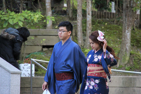 maiko: Kyoto, Japan - April 11, 2015: Unidentified Japanese couple wear beautiful Japanese traditional garment, at Kiyomizudera in Kyoto, Japan.