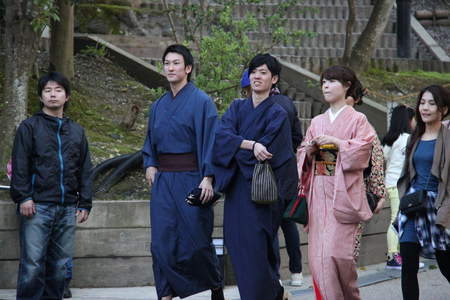 Kyoto, Japan - April 11, 2015: Unidentified Japanese people wear beautiful Japanese traditional garment, at Kiyomizudera in Kyoto, Japan.