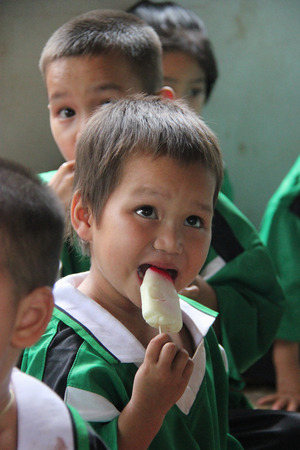 insufficient: Kanchanaburi, Thailand - July 21, 2013: Poor children enjoy having ice cream after people donate them food.