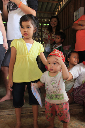 Kanchanaburi, Thailand - July 21, 2013: The Mon, an ethnic group from Myanmar living along border of Thailand, assimilated to Thai culture long ago, but they keep Myanmar cultural lifestyle.