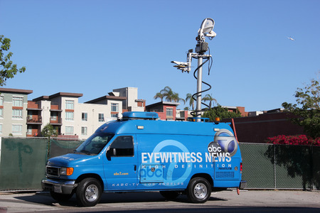 Los Angeles, California, USA - August 16, 2015: Broadcasting vehicle of American Broadcasting Company ABC is preparing to report a news.