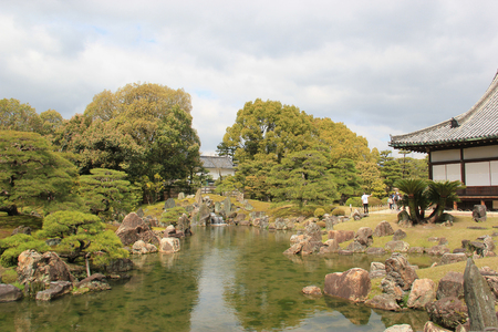 designated: Kyoto, Japan - April 11, 2015: Japanese Style Garden at Nijo Castle, one of the seventeen Historic Monuments of Ancient Kyoto designated by UNESCO as a World Heritage Site.