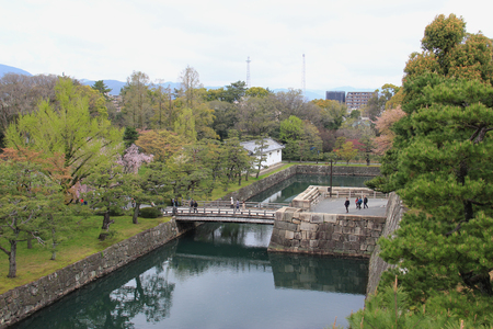 moat wall: Kyoto, Japan - April 11, 2015: Nijo Castle, a flatland castle in Kyoto, is one of the seventeen Historic Monuments of Ancient Kyoto designated by UNESCO as a World Heritage Site. Editorial